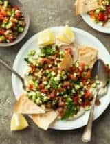 Middle Eastern Chopped Tomato Cucumber Salad on Whipped Tahini (Paleo, Vegan)