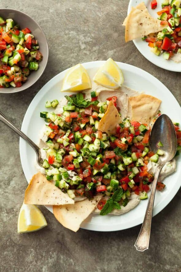 Middle Eastern Chopped Tomato Cucumber Salad on Whipped Tahini