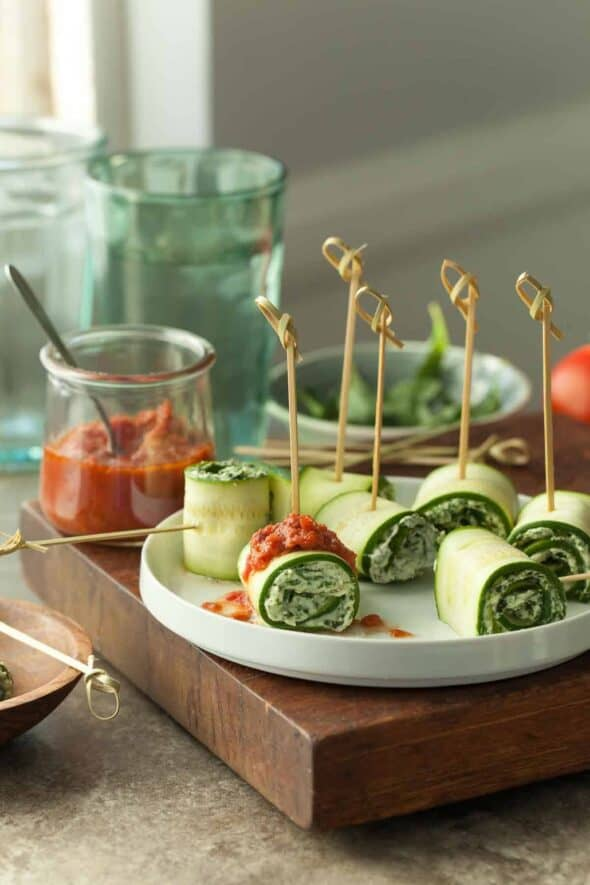 Vegan Zucchini Roll Ups with Raw Marinara Sauce on Plate