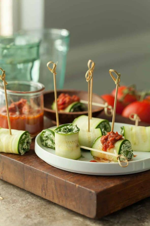 Vegan Zucchini Roll Ups Served with Raw Marinara Sauce on Plate