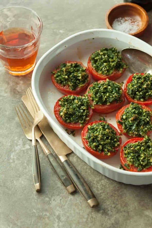 Provençal Tomatoes in Serving Dish with Glass of Wine