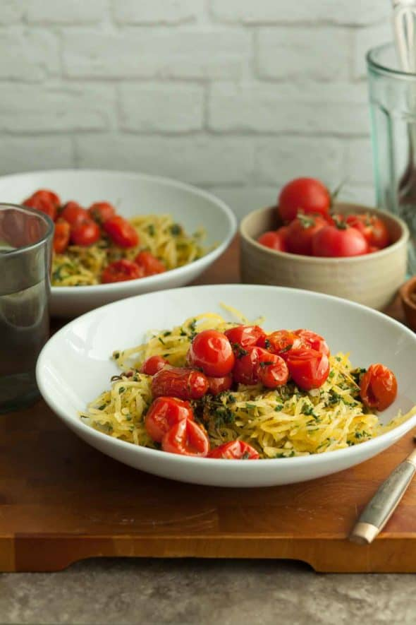 Garlic and Herb Spaghetti Squash with Roasted Tomatoes in Bowls on Wood Board
