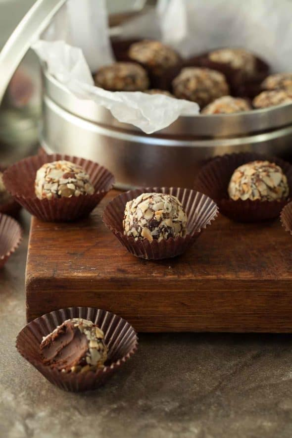 Chocolate Almond Fudge Truffles in Paper Cups with a Bite Taken.