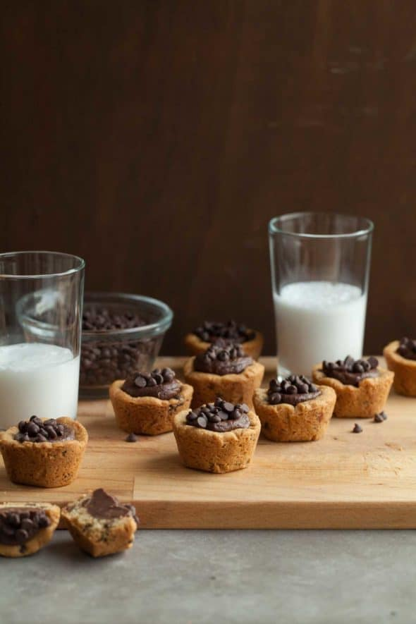 Gluten-Free Chocolate Chip Cookie Cups Filled with Fudge and Topped with Mini Chocolate Chips