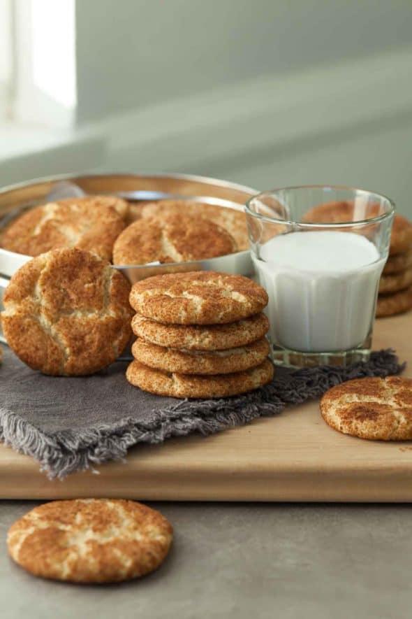 Gluten-Free Snickerdoodles Stacked near Glass of Milk