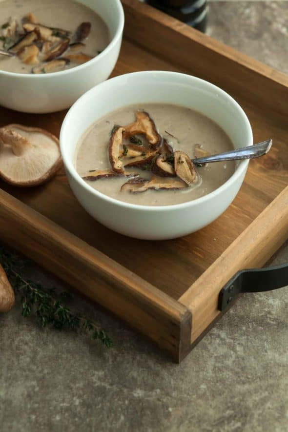 Roasted Mushroom Cauliflower Soup in Bowl Topped with Mushrooms