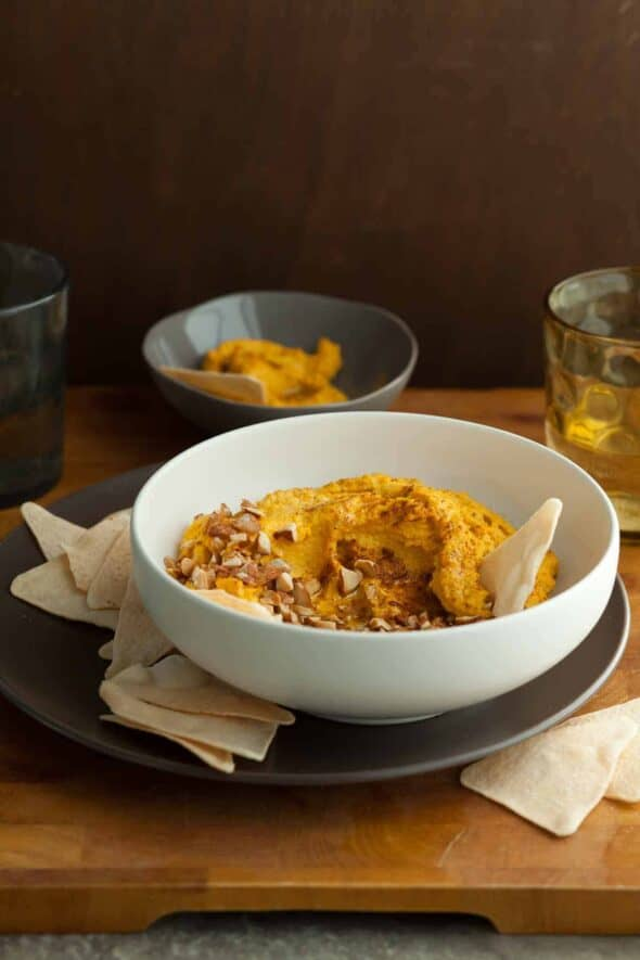 Spicy Carrot Dip on Serving Plate with Chips