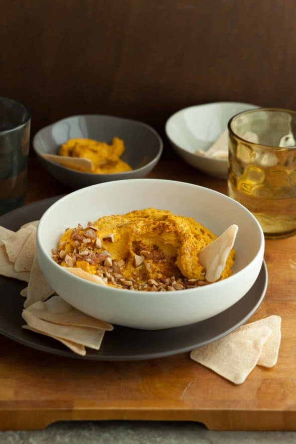 Spicy Carrot Dip in Bowl with Chips
