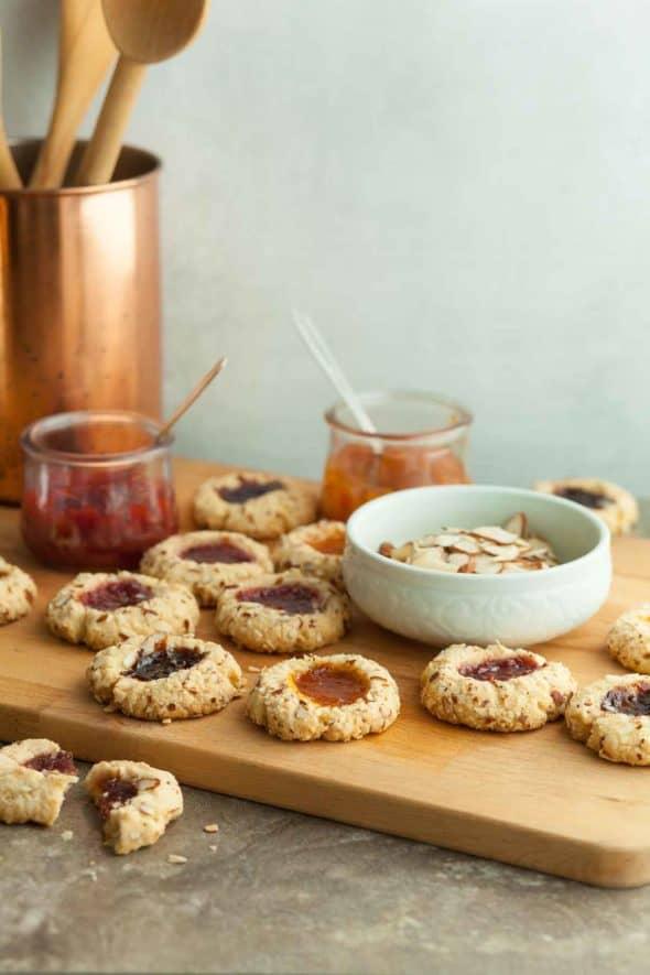 Gluten-Free Jam Thumbprint Cookies on Board with Jam Jars