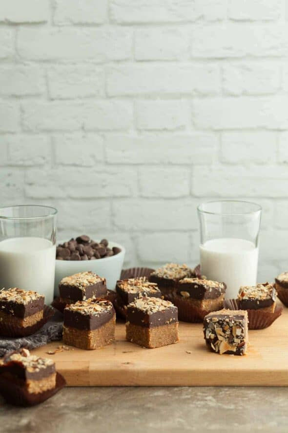No-Bake Chocolate Almond Butter Bars on Serving Board with Milk Glasses