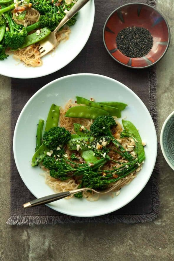 Sesame Kelp Noodles with Snow Peas and Broccolini Topped with Sesame Seeds and Cashews