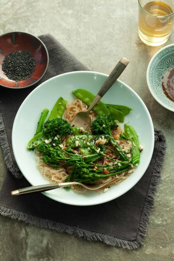 Sesame Kelp Noodles with Snow Peas and Broccolini in Plate on Napkin