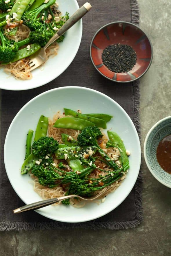 Sesame Kelp Noodles with Snow Peas and Broccolini in Plates with Sesame Seeds and Sauce on Side