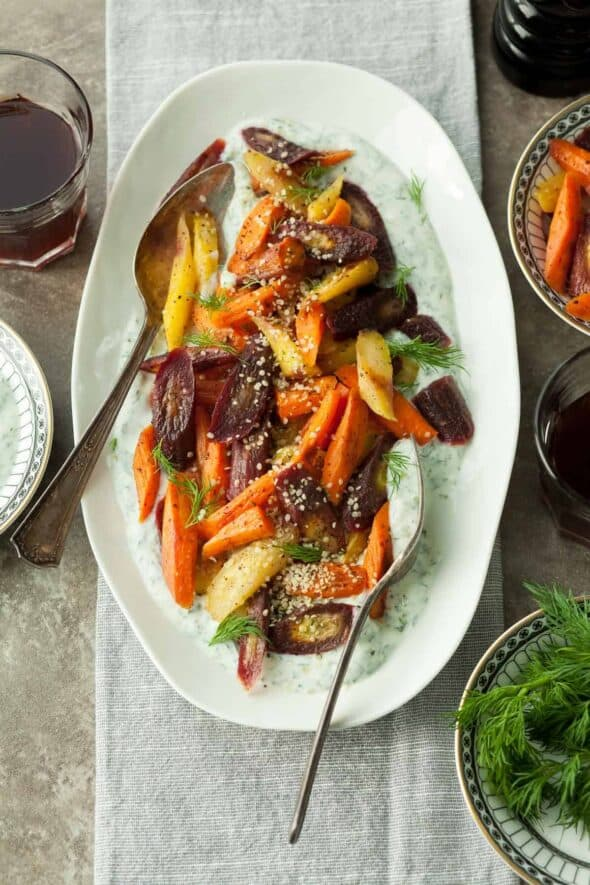 Sumac Roasted Carrots with Herbed Yogurt on Serving Platter