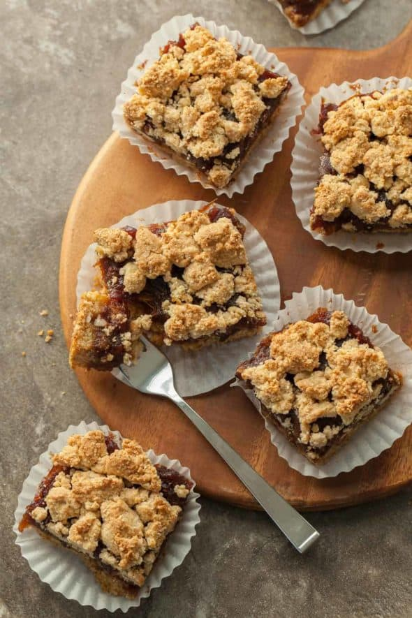 Gluten-Free Pecan Date Bars on board with fork