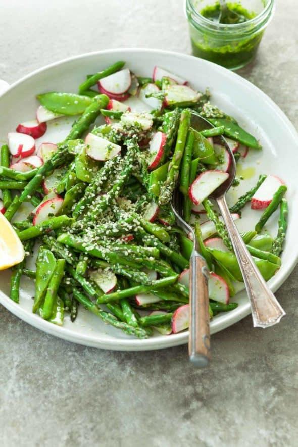 Sautéed Asparagus and Snow Peas with Lemon Dill Oil on Plate with Fork and Spoon