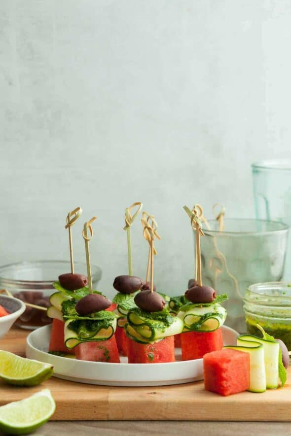 Vegan Watermelon Skewers with Cucumber and Lime Mint Oil on Plate