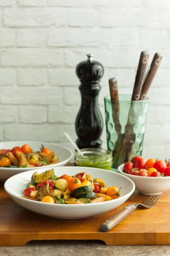 Gluten-Free Cherry Tomato and Zucchini Pesto Pasta in White Bowls