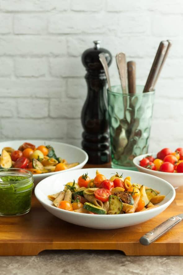 Gluten-Free Cherry Tomato and Zucchini Pesto Pasta in Dishes on Cutting Board
