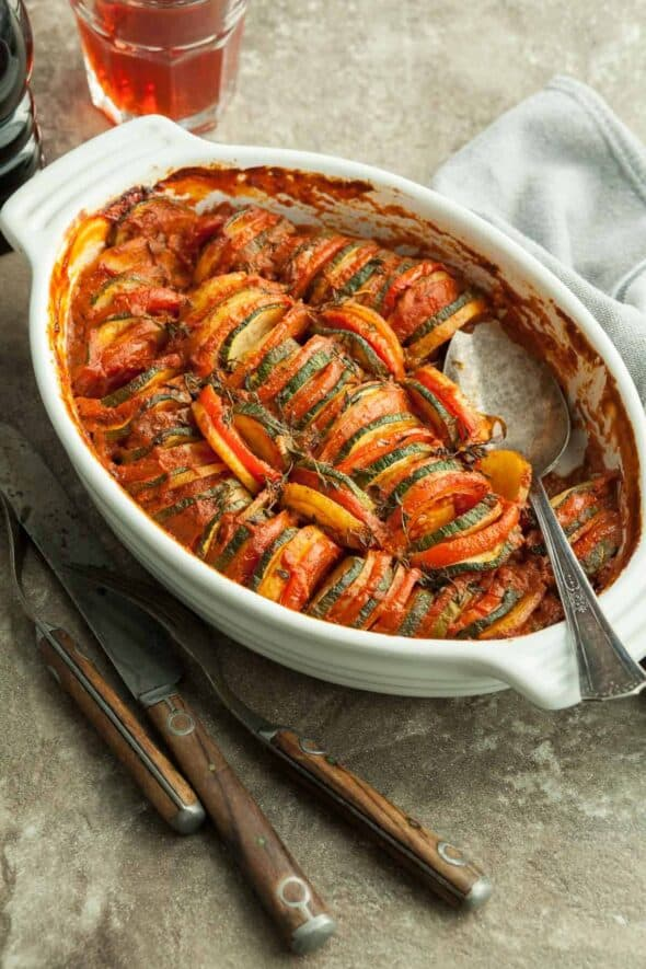 Provencal Vegetable Tian in Casserole with Spoon
